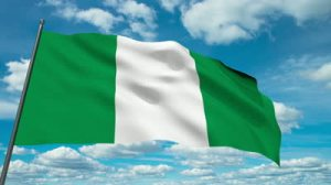 stock-footage-nigeria-flag-waving-against-time-lapse-clouds-background